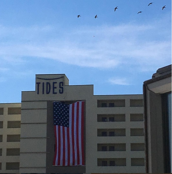 the tides hotel view from st james gate folly beach island yoga american flag pelicans